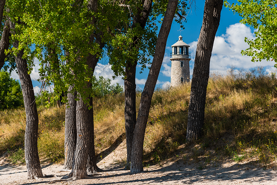 Lake Minatare Lighthouse, Minatare, Nebraska – Lake Minatare offers sandy beaches and loads of fun. Encompassed by large cottonwood trees there's plenty of shade and wildlife to enjoy. Image: Lighthouse as seen from the south inlet. ©Hawk Buckman