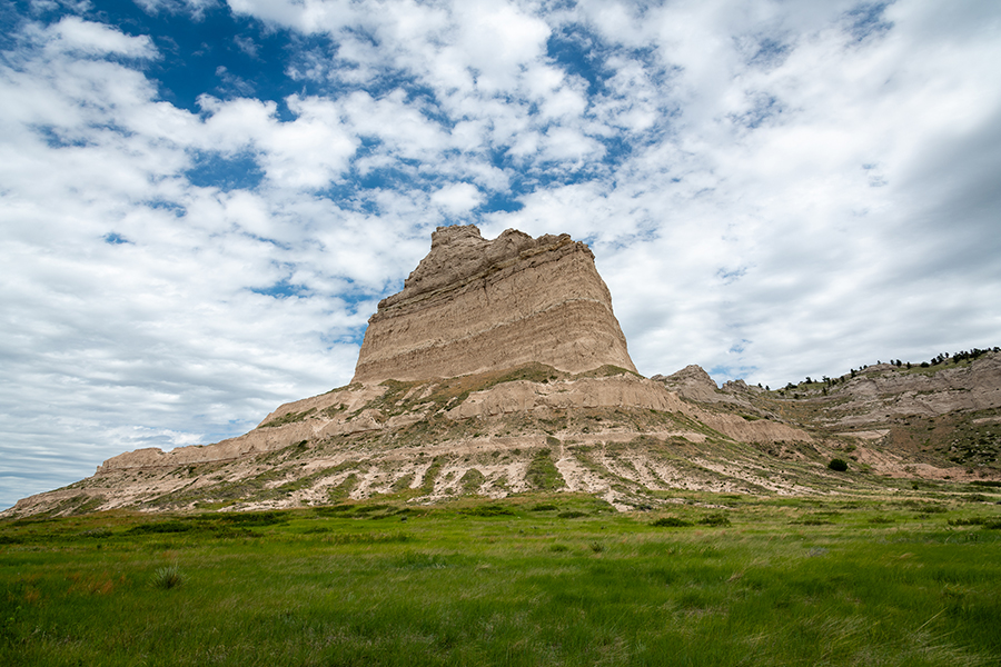 "Eagle Rock – A feature often referred to as ""Hell's Gate"" by early immigrants along the Mormon and Oregon Trails, Eagle Rock stands to the North of Mitchell pass at Scotts Bluff National Monument and is separated by paved road from Sentinel Rock to the South."