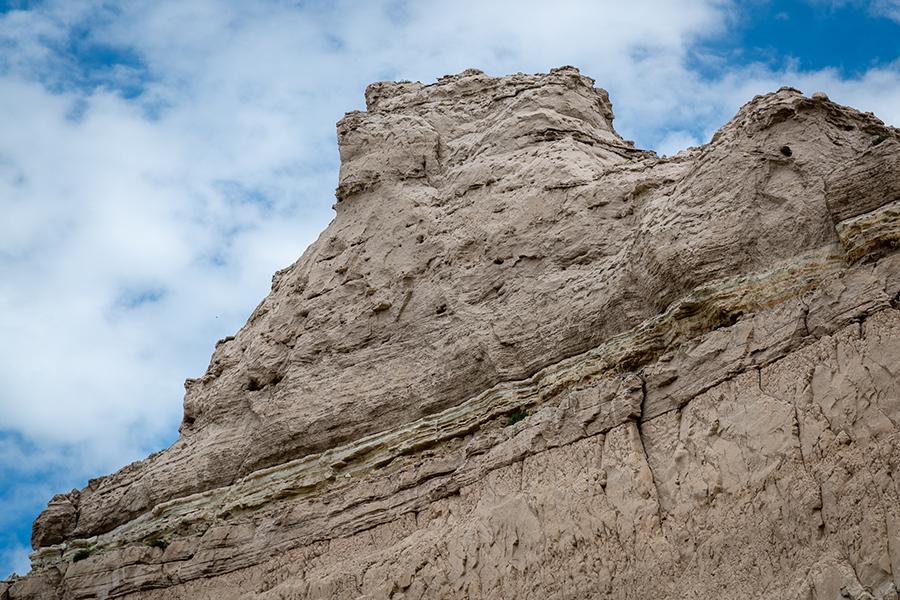 "Eagle Rock – The top of Eagle Rock as seen from the ground near the Ranger station reveals ""pipy"" concretions and the remnants of sand dunes that once roamed western Nebraska about 20 millions years ago."