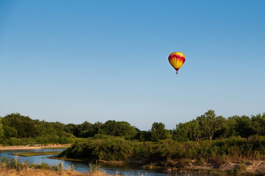 Kelli Cook floats high above the North Platte River south of Mitchell, Nebraska during the Old West balloon Fest in August of 2020.  Photo: Hawk Buckman