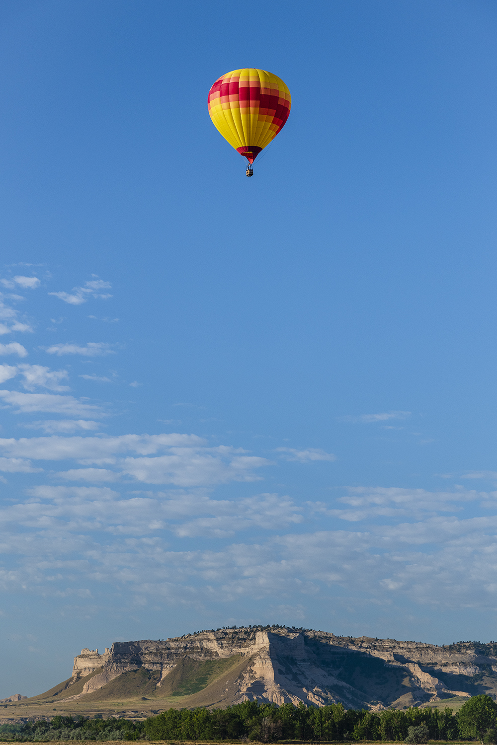 Kelli Cook floats high above the Scotts Bluff National Monument during the Old West Balloon Fest in August of 2020.  Photo: Hawk Buckman